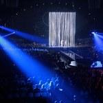 Blue spotlight on concert — Stock Photo