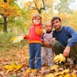Father with children in autumn wood — Stock Photo