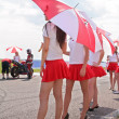 Paddock-girls with umbrellas — Stock Photo
