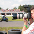 Photographer on motorcycle race - Stock Photo