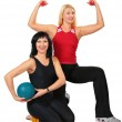 Two sport women with ball and dumbbells — Stock Photo #7448028