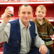 Grandfather and grandson in food shop - Foto Stock