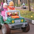Children in toy car — Stock Photo