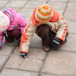 Two children with chalk on road — Stock Photo #7448681