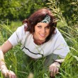 Young brown-haired womin grass — Stock Photo #7448691