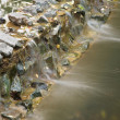 Stock Photo: Water flowed through stones