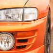 Orange sport car - Stock Photo