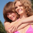 Stock Photo: Two girls embraces outdoor