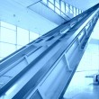 Glass hall with escalator — Stock Photo