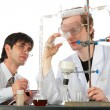 Two chemists with chemical equipment — Stock Photo