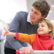 Father with child in shop — Stock Photo #7449422