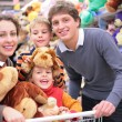 Family in shop with soft toys — Stock Photo