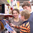 Parents with son in toy shop — Stock Photo