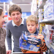 Parents with son with toy in shop — Stock Photo