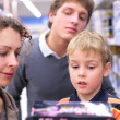 Father and mother with son with toy in shop — Stock Photo