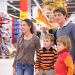 Family in supermarket — Stock Photo