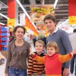 Royalty-Free Stock Photo: Parents with children in supermarket