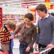 Royalty-Free Stock Photo: Father and mother with son in supermarket