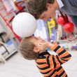 Stock Photo: Father with son and ball in shop