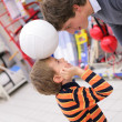 Father with son and ball in shop — Stock Photo