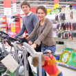 Family on sports training apparatus in shop — Stock Photo