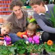 Family in flower shop — Foto de Stock