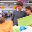 Family choose fabric in shop — Stock Photo