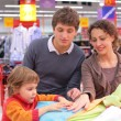 Family choose linen in shop — Stock Photo #7449520