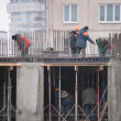 Stock Photo: Workers construct building