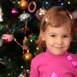 Christmas fir and little girl — Stock Photo