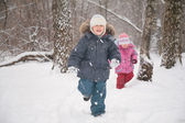 Two children in forest in winter — Stock Photo