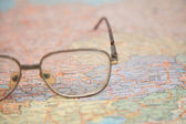Close-up of glasses on map of europe — Stock Photo