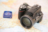 Camera and compass on map of europe — Foto de Stock