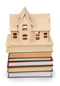 Toy house on pile of books — Stock Photo