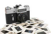 Old camera and slides — Stock Photo