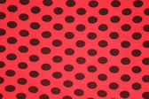 Red with black spots textile texture — Stock Photo