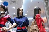 Three mannequins in store — Stock Photo