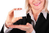 Woman showing white card for text 2 — Stock Photo