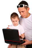 Father and son working with notebook — Foto Stock