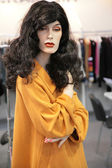 Woman mannequin in yellow dress — Stock Photo