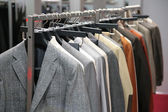 Clothes on racks in shop — Stock Photo