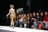Fashion model on podium from back — Stock Photo