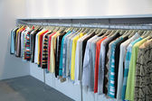 Clothes on racks — Stock Photo