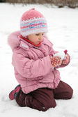 Little girl play with snow in winter — Stock Photo