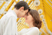 Boy and girl look at each other with love — Stock Photo