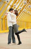 Young couple on footbridge — Stock Photo