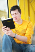 Asian boy reads bible — Stock Photo