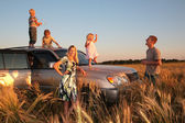 Family on offroad car — Stock Photo