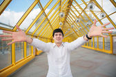 Young asian man shows salutatory gesture — Stock Photo