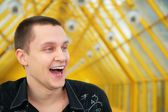 Laughing young man in black shirt — Stock Photo